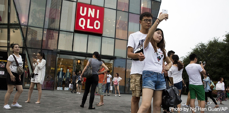 Random Couple Taking Selfie Outside Uniqlo